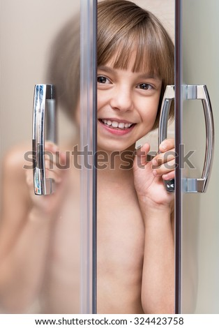 Happy girl takes a shower in the bathroom - stock photo