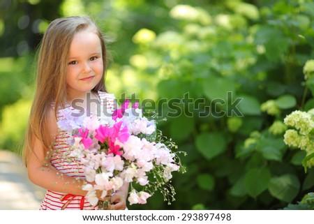 happy girl walking in park - stock photo