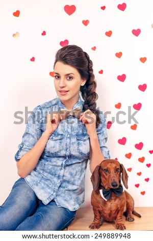 happy girl with a dog dachshund against the background of the heart. close-up, International Women's Day, Valentine's Day, March 8, Mother's Day - stock photo