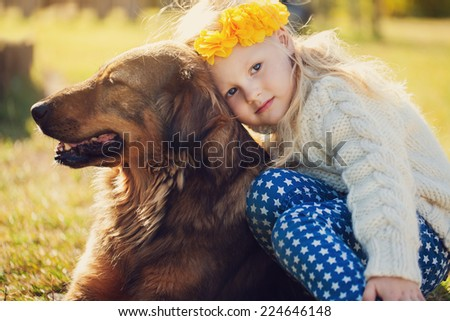 Happy girl with a dog in park - stock photo