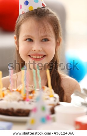 Happy girl with birthday cake