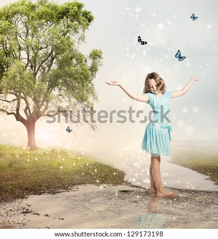 Happy Girl with Blue Butterflies at a Magical Brook - stock photo