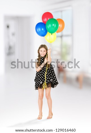 happy girl with colorful balloons over white - stock photo