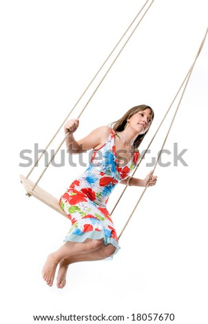 Happy Girl with Colorful Dress Swinging