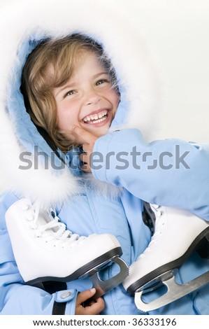Happy girl with figure skates - stock photo