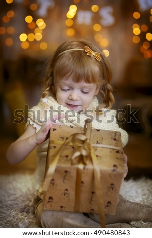 Happy girl with gifts at Christmas Eve