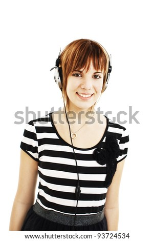 Happy girl with headphones on white background - stock photo
