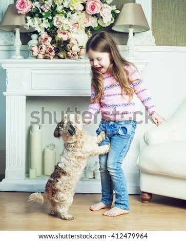 happy girl with her dog at home - stock photo