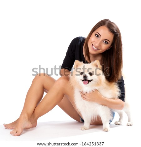 Happy girl with her puppy - isolated over a white background