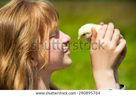 Happy girl with little chicken - stock photo