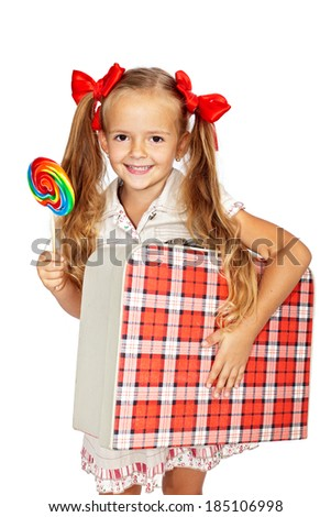 Happy girl with lollipop candy and vintage suitcase - isolated - stock photo