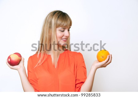 Happy girl with orange and apple isolated on white