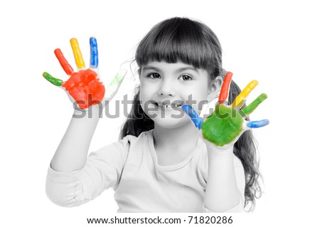 Happy girl with paint on her palms isolated on white monochrome
