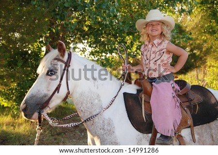 Happy girl with pony. - stock photo