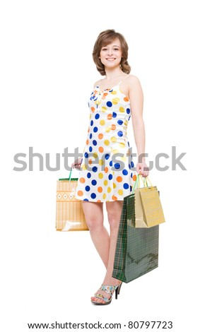 happy girl with purchases. white background, it is isolated