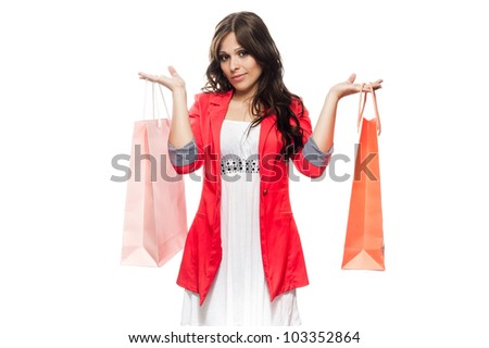 Happy girl with shopping bags isolated on white background - stock photo