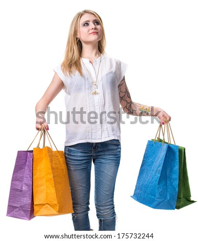 Happy girl with shopping bags  on a white background