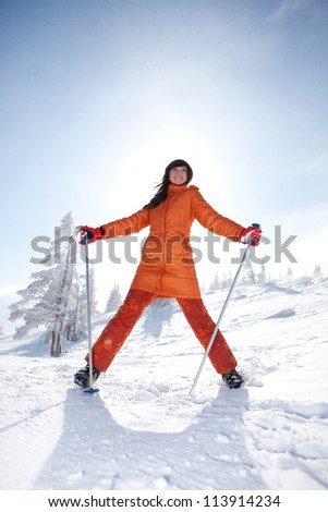 Happy girl with ski in the winter landscape - stock photo