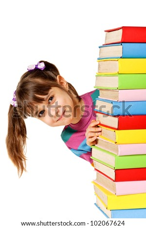 Happy girl with stack color books. Isolated over white - stock photo