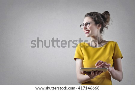 Happy girl with tablet - stock photo