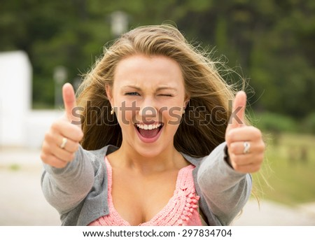 Happy girl with thumbs up - stock photo