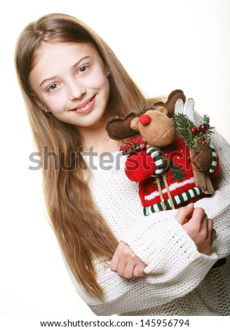 Happy girl with toy deer - stock photo