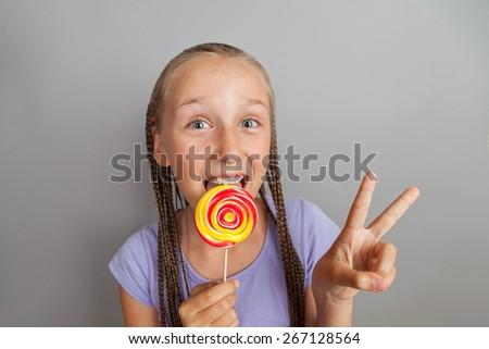 happy girl woman with lollipop - stock photo