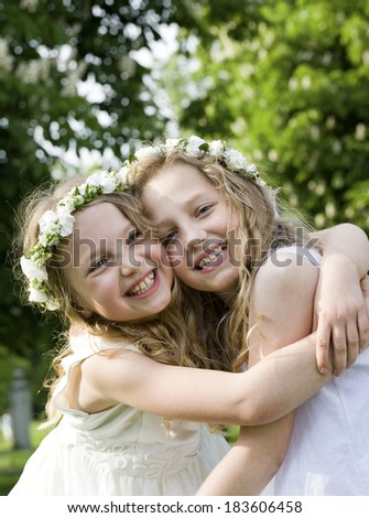 Happy girlfriends - First Communion - stock photo
