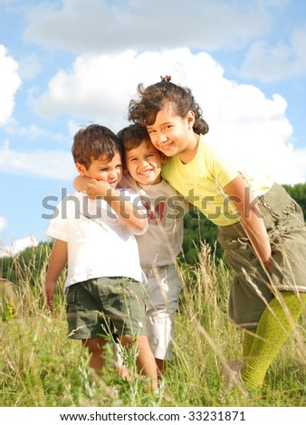 Happy girls and boys in nature smiling - stock photo