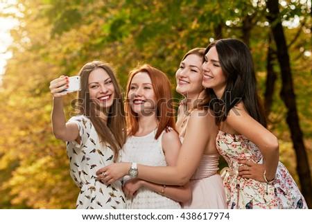 happy Girls Friends making selfie outdoor - stock photo