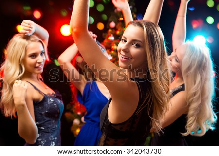 Happy girls fun dansing at a party - stock photo