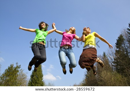 happy girls jumping high