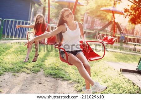 happy girls on playground - stock photo