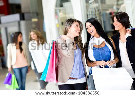 Happy girls out shopping at the mall - stock photo