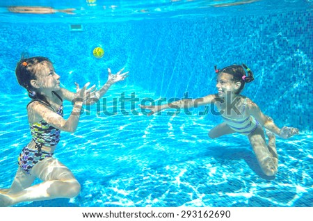 Happy girls swim underwater in pool and having fun, children on summer  vacation, kids sport concept  - stock photo