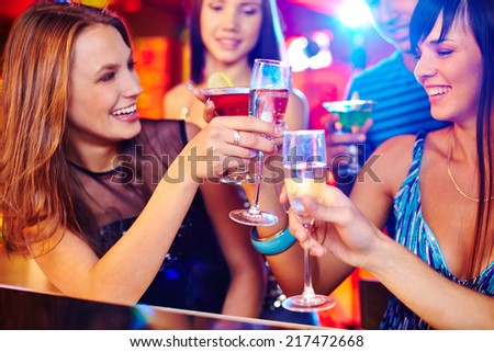Happy girls toasting with champagne at party - stock photo