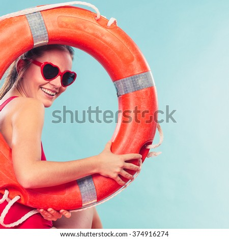 Happy glad young woman girl in heart shape sunglasses with ring buoy lifebuoy. Summer safety security. - stock photo