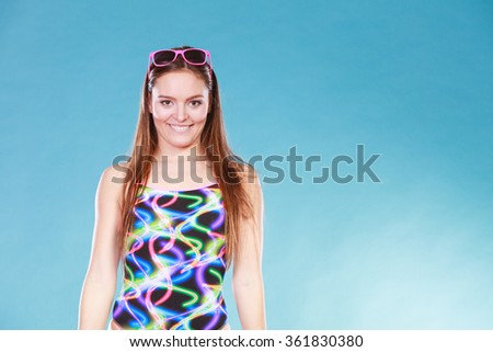 Happy gorgeous young woman girl in swimsuit swimwear with sunglasses on blue. Summer holiday vacation relax. - stock photo