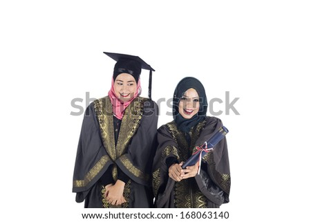 Happy graduate asian muslim student with diploma isolated on white