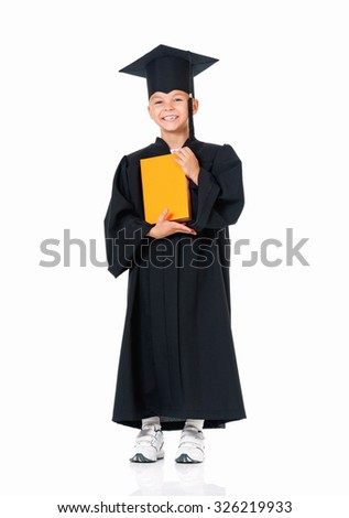 Happy graduate boy student in mantle with book, isolated on white background