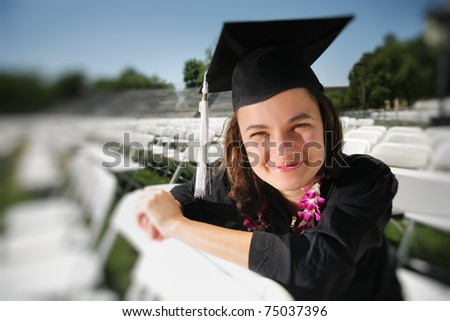 Happy graduate looking at camera. Closeup, shallow DOF.