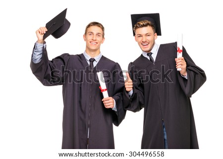 Happy graduates. Young handsome students expressing positivity. Isolated on white. - stock photo