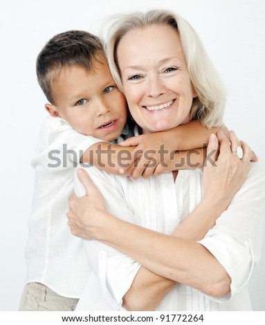 Happy grand mother with grandchild on shoulders - stock photo