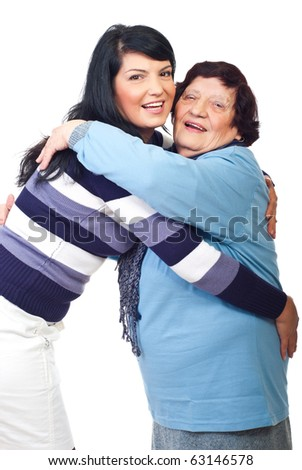 Happy granddaughter and grandmother embracing and smiling together isolated on white background - stock photo