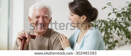 Happy grandfather and granddaughter spending time together