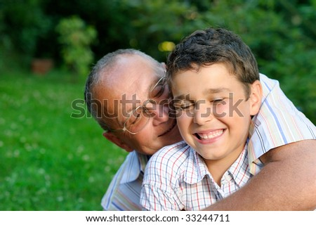 Happy grandfather and kid outdoors