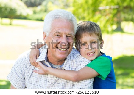 Happy grandfather with his grandson on a sunny day - stock photo