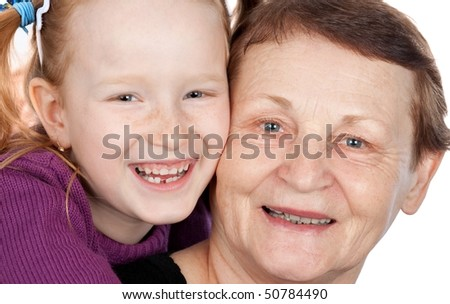 Happy grandma and granddaughter isolated on white