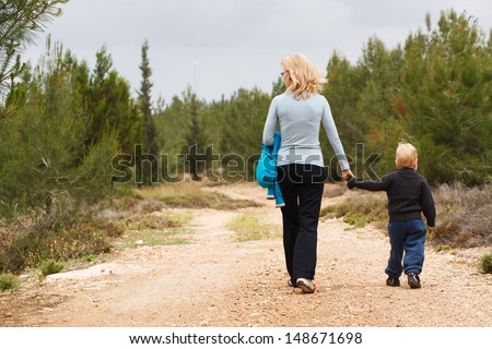 Happy Grandma  with her grandson walk on nature - stock photo