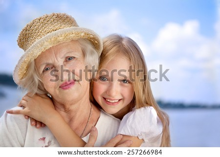 Happy Grandmother and Granddaughter in the Sunny Day. - stock photo